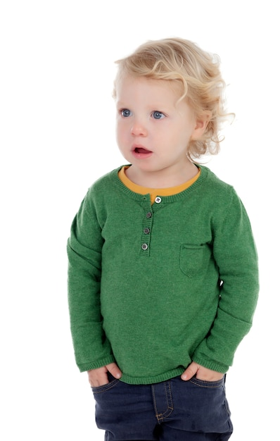 Adorable blond baby with hands in the pockets Premium Photo