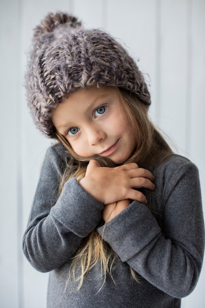 Adorable blonde girl with winter hat Free Photo