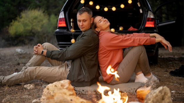Adorable couple enjoying bonfire Free Photo