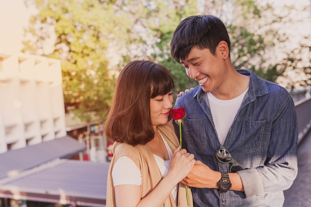 Adorable couple with a rose in hands Free Photo