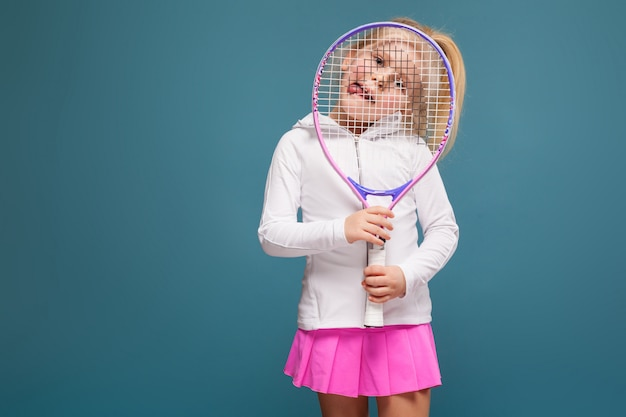 Adorable cute little girl in white shirt, white jacket and pink skirt with tennis racket Premium Photo
