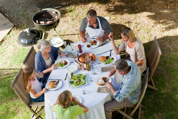 Adorable family eating in the garden Premium Photo