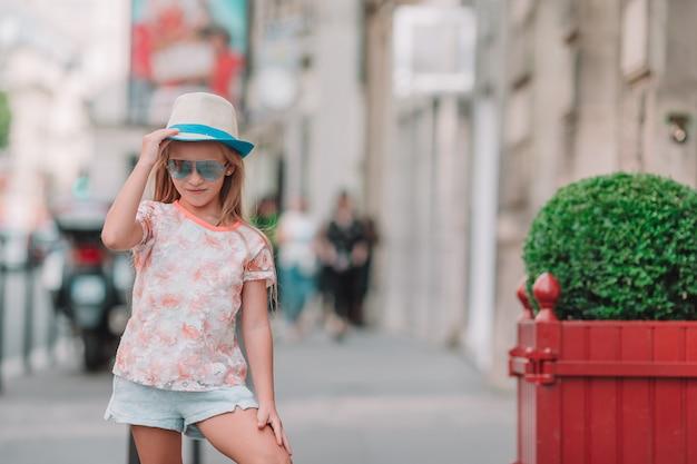 Adorable fashion little girl outdoors in european city Premium Photo