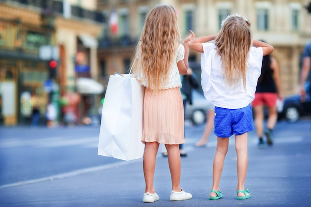 Adorable fashion little girls outdoors in european city Premium Photo