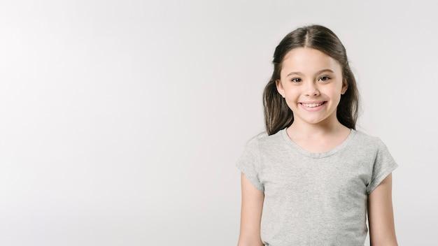 Adorable girl standing in studio Free Photo