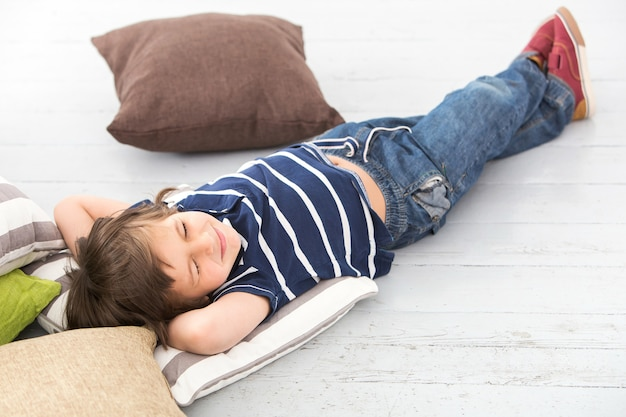 Adorable kid on the floor Free Photo