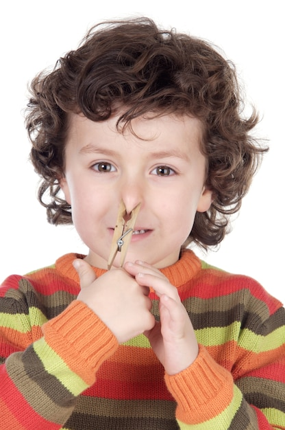 Adorable kid with a clothespin in his nose Premium Photo