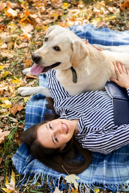 Adorable labrador playing with woman Free Photo