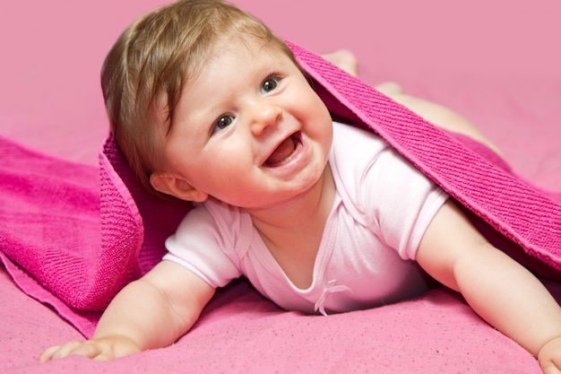 An adorable, laughing baby looking at camera Premium Photo