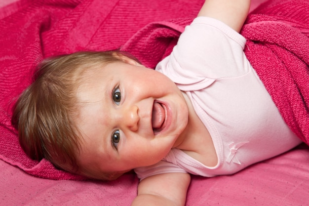 An adorable, laughing baby looking Premium Photo