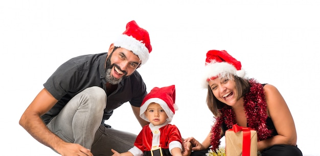 Adorable little baby with his parents at christmas parties on isolated white background Premium Photo