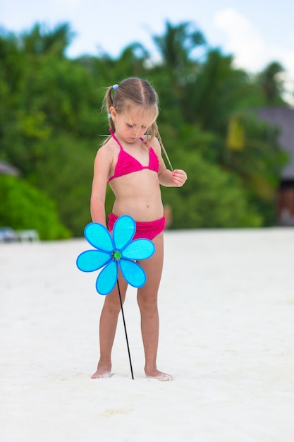 Adorable little girl at beach during summer vacation Premium Photo