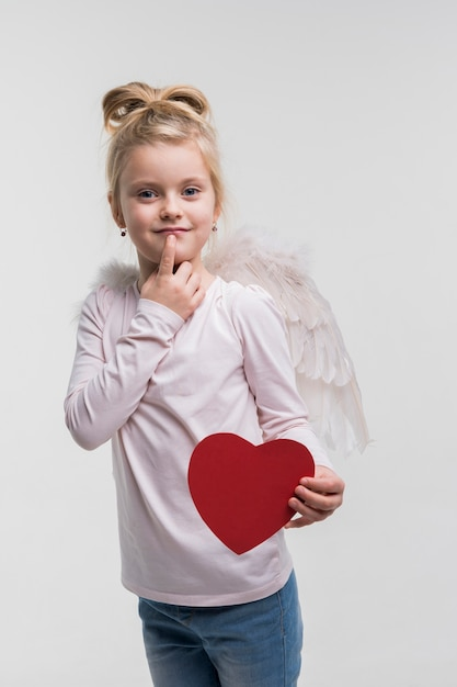 Adorable little girl dressed up as an angel Free Photo
