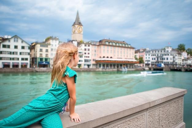 Adorable little girl outdoors in zurich Premium Photo