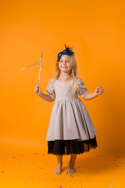 Adorable little girl with mask in costume Free Photo