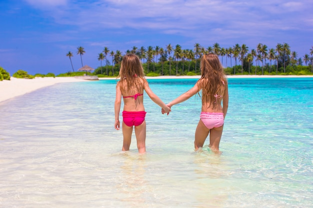 Adorable little girls at beach during summer vacation Premium Photo