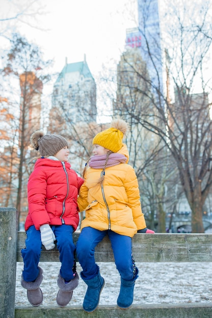 Adorable little girls in central park at new york city Premium Photo