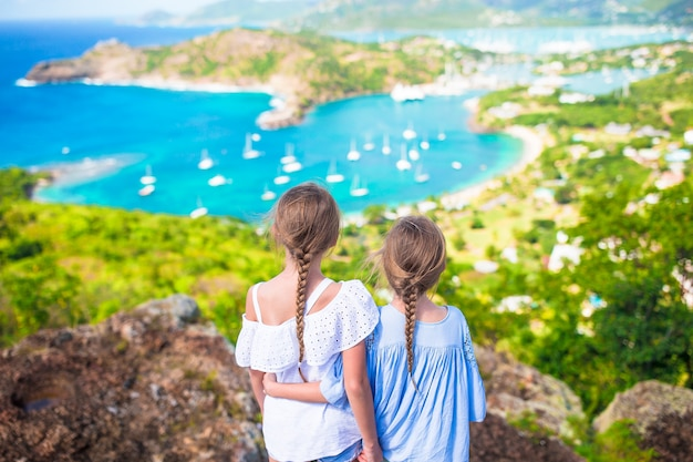 Adorable little kids enjoying the view of picturesque english harbour at antigua in caribbean sea Premium Photo
