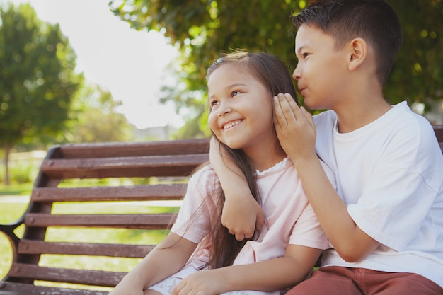Adorable little kids enjoying warm sunny day at the park Premium Photo