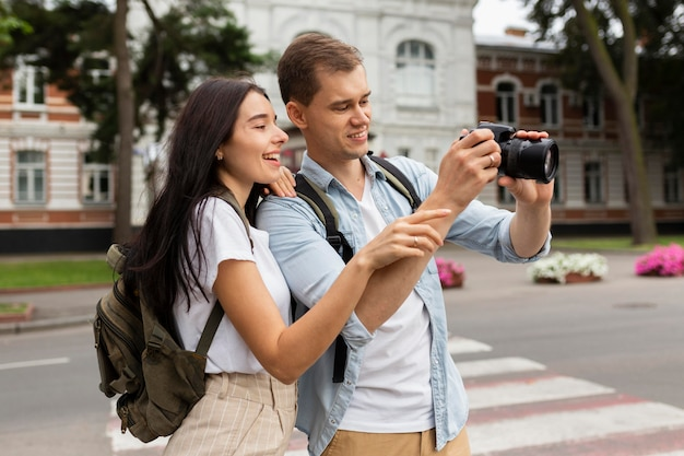 Adorable man and woman taking pictures on vacation Premium Photo