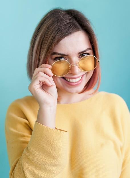 Adorable model holding glasses Free Photo