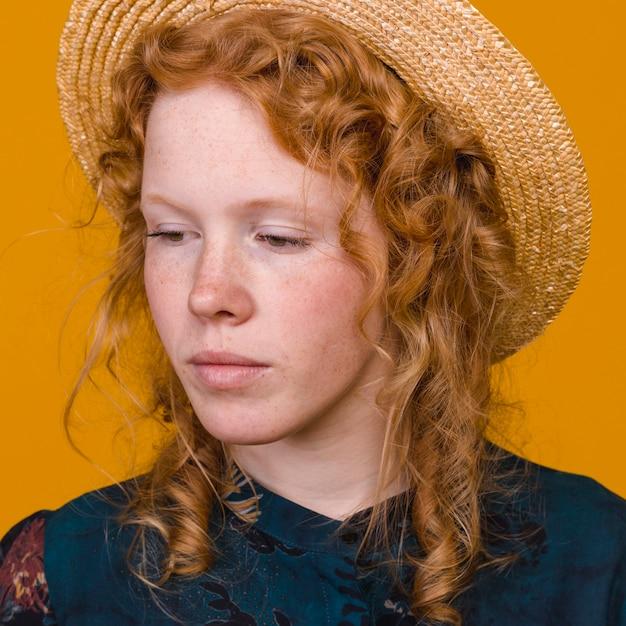 Adorable redheaded woman in studio Free Photo