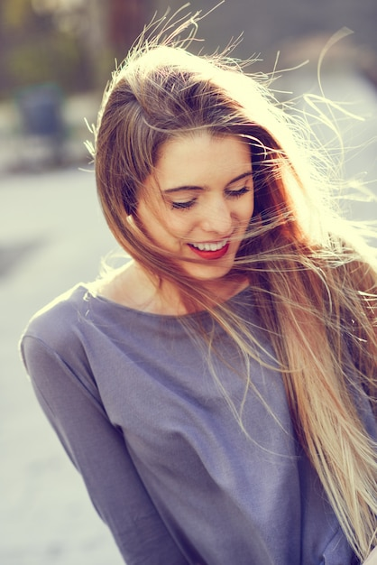 Adorable teen laughing with closed eyes Free Photo