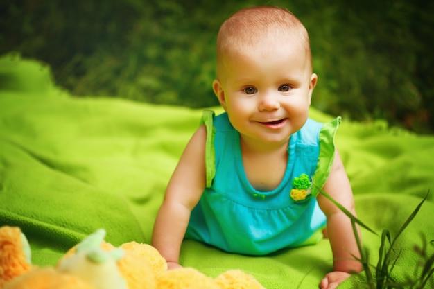 Adorable toddler baby girl playing Premium Photo