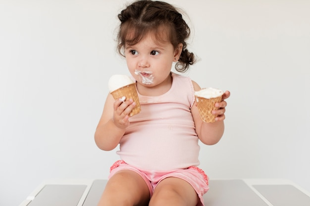 Adorable young baby girl with ice cream Free Photo