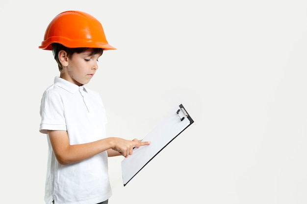 Adorable young child with safety helmet Free Photo