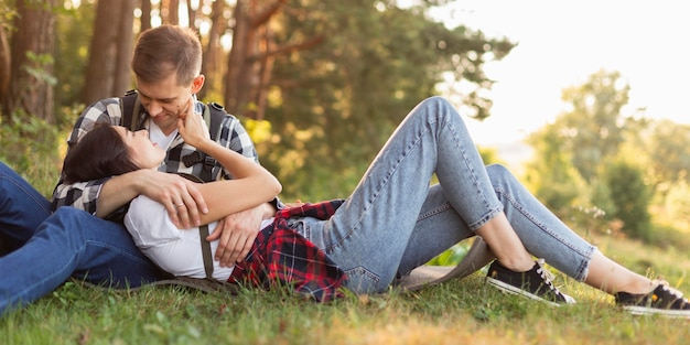 Adorable young couple enjoying time in the nature Free Photo