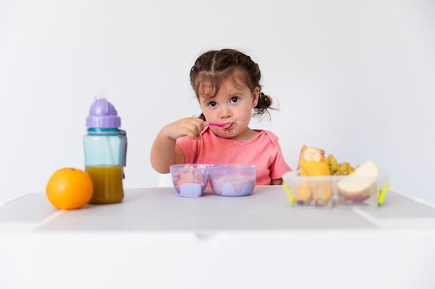 Adorable young girl serving breakfast Free Photo