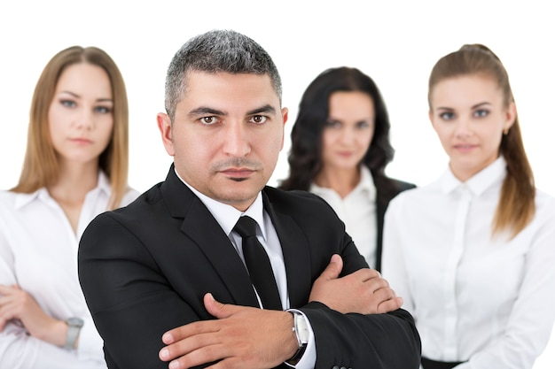 Adult businessman standing in front of his colleagues with his arms crossed on chest. group of business people team. Premium Photo