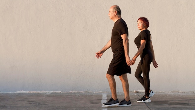 Adult couple doing sport and walking Premium Photo