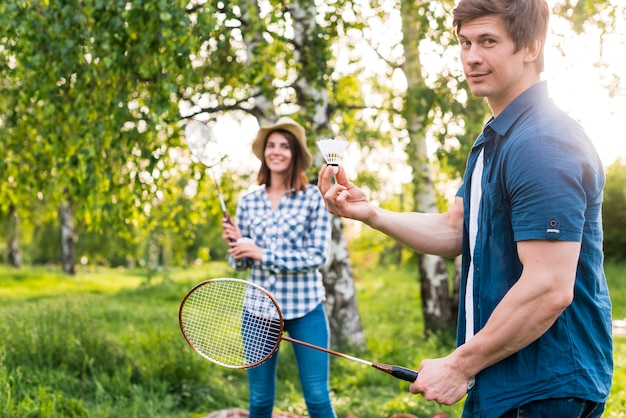 Adult couple playing badminton in park Free Photo