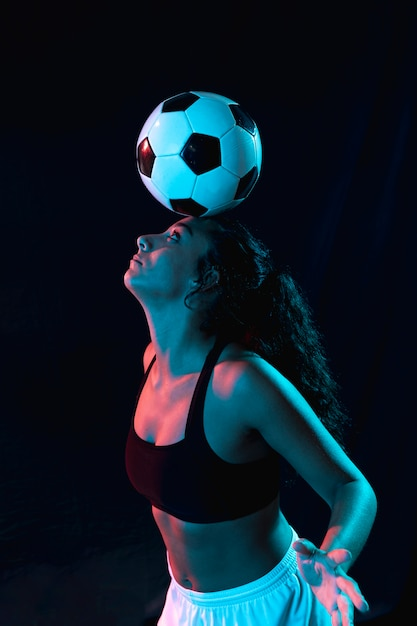 Adult fit girl doing tricks with ball Free Photo