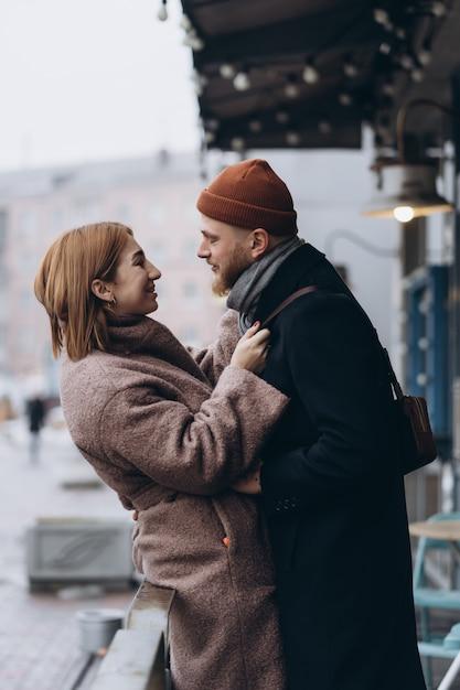 Adult loving couple walking on a street Free Photo
