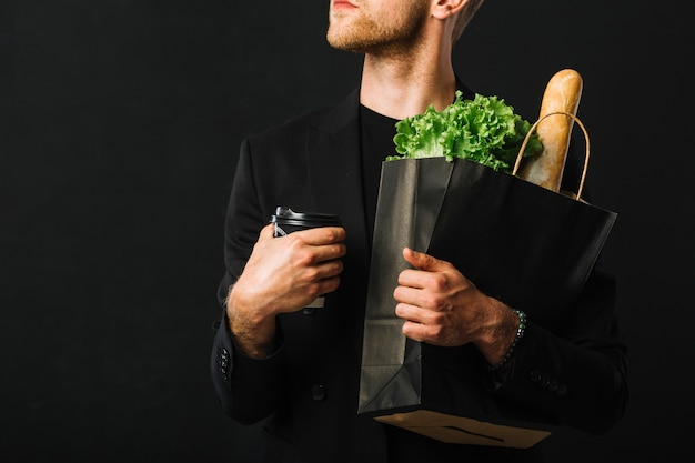 Adult male holding groceries bag Free Photo