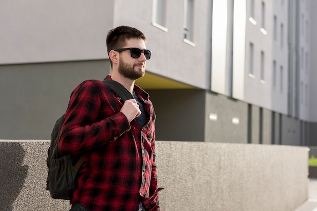Adult man in casual clothes with backpack Free Photo