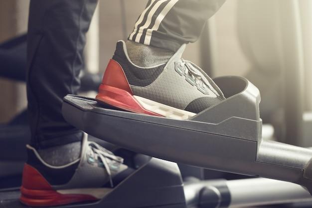 Adult man making cardio training exercises in gym club closeup horizontal Free Photo