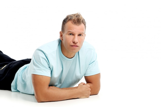 Adult man with a shirt posing in studio Free Photo
