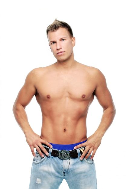 Adult man without shirt posing in studio Free Photo