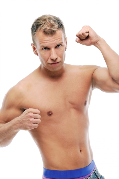 Adult man without shirt posing in studio Free Photo