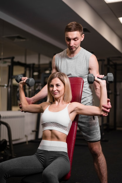 Adult man and woman working out at the gym Free Photo