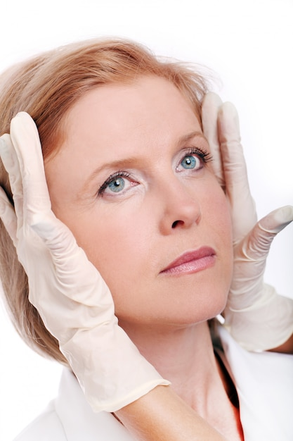 Adult woman having face injection Free Photo