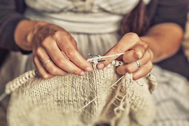 Adult woman knits Premium Photo