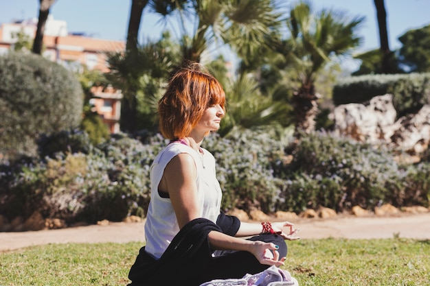 Adult woman meditating in park Free Photo