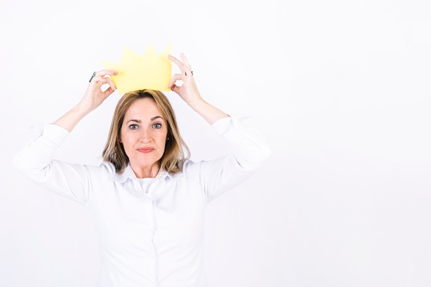 Adult woman in paper crown Free Photo