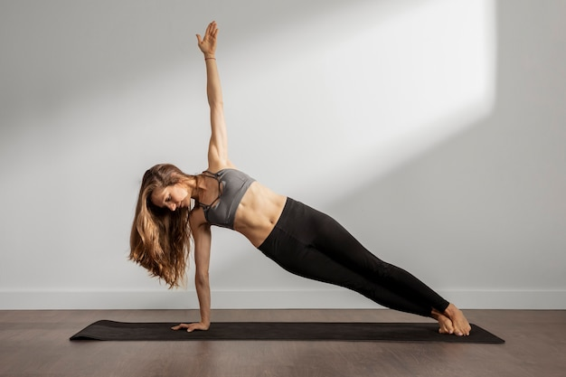 Adult woman practicing yoga at home Free Photo