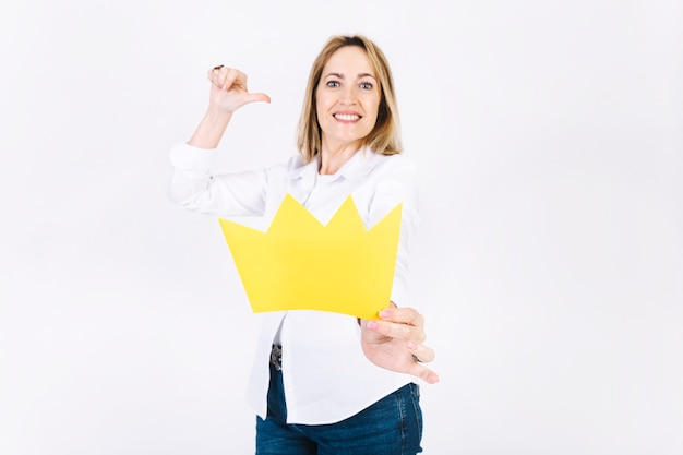 Adult woman showing paper crown Free Photo